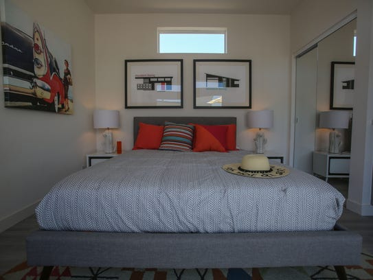 The bedroom of a one bedroom micro home in Palm Springs.