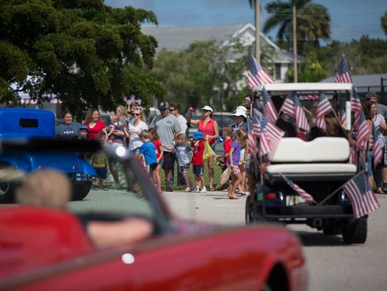 Cars and floats participate in the Independence Day
