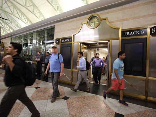 Passengers aboard a Northeast Corridor train arrive