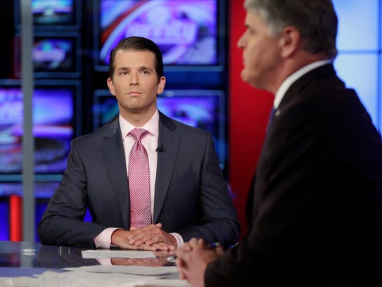 Donald Trump Jr., left, is interviewed by host Sean