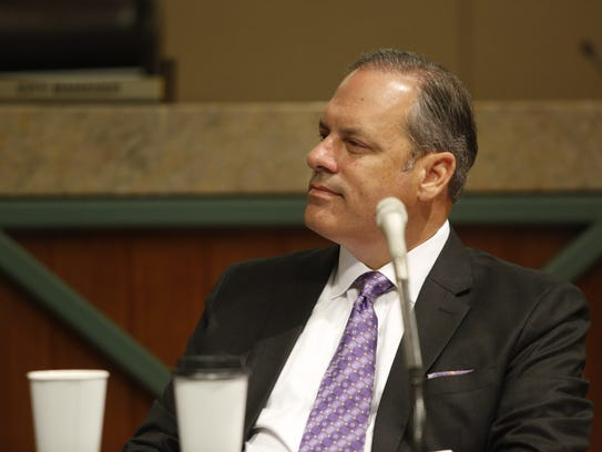 City Commissioner Scott Maddox listens to comments