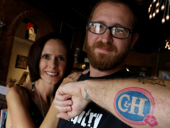 Casey Carr, and his wife Heidi, show off Casey's tattoo