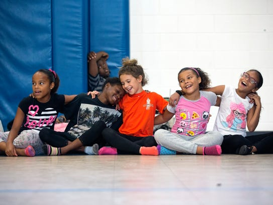 Kids sway and sing along during rehearsal for the end
