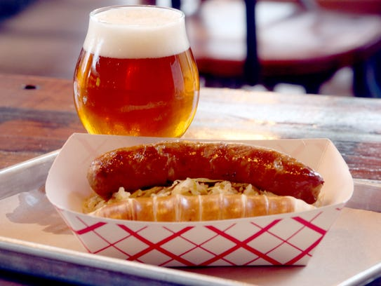 Bratwurst with homemade kraut and a pretzel stick at