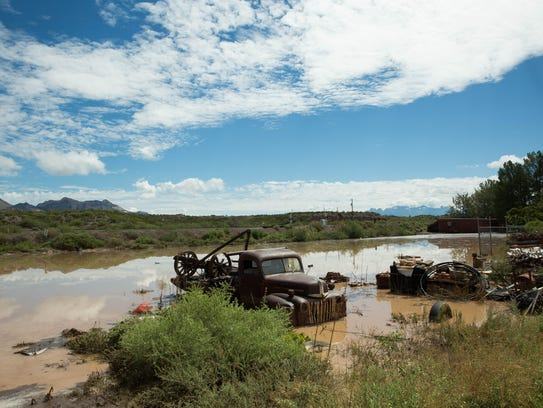 Vehicles and equipment at the corner of Doña Ana Road