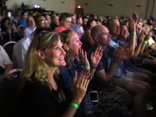 Fans watch Lynda Carter sing at the Comic Con Palm