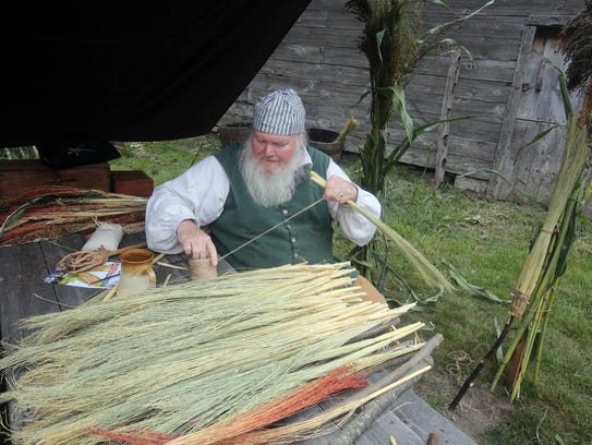 Tom Hunt makes a broom out of broom corn during CORNucopia
