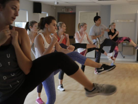 A class at Drip Drop Fitness on Tennessee Street works
