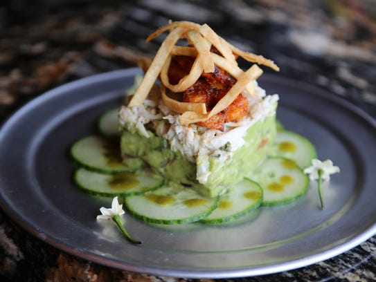 A tapas special of marinated shrimp, lump crab, guacamole