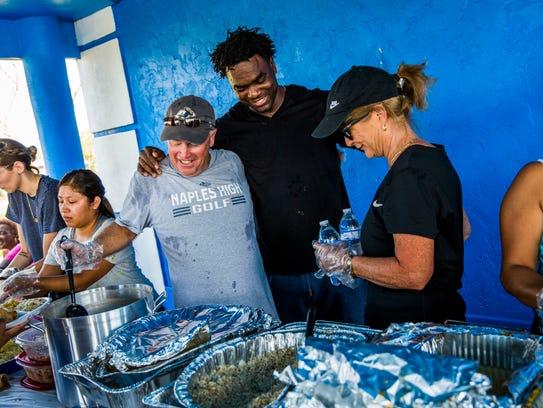 Former NFL running back Edgerrin James greets volunteers
