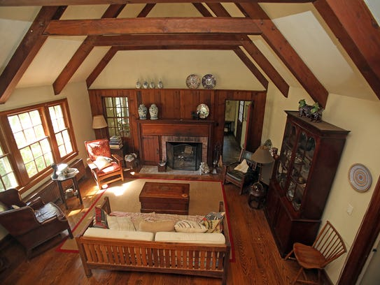 A view of the living room in a converted carriage house