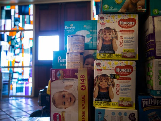 Donated supplies sit in the lobby of Saint John the