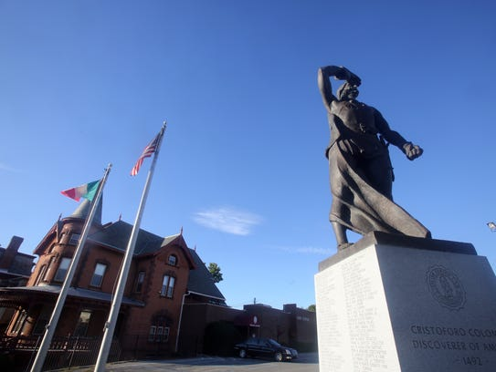 The statue of Christopher Columbus in front of the