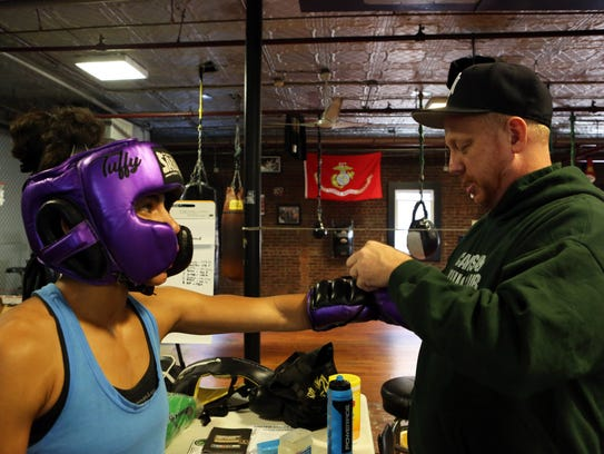 Coach Ryan O'Leary helps professional boxer Natalie
