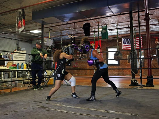 Natalie Gonzalez, right, of New Rochelle boxes Vanessa