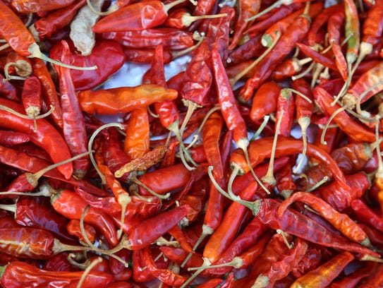 Bandhu Gardens' peppers dry in the sun in Detroit's