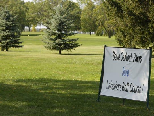 "A sign urges visitors to ""Save Oshkosh Parks: Save"