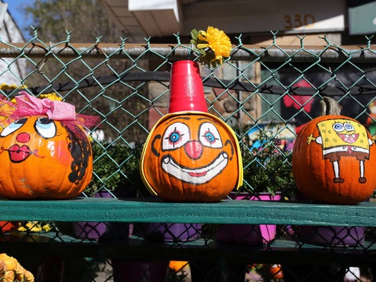 """Some of the pumpkins painted by Joanna """"Ginger"""" Cardilli"""