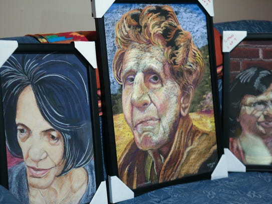 Some of the framed pastel portraits that will be in