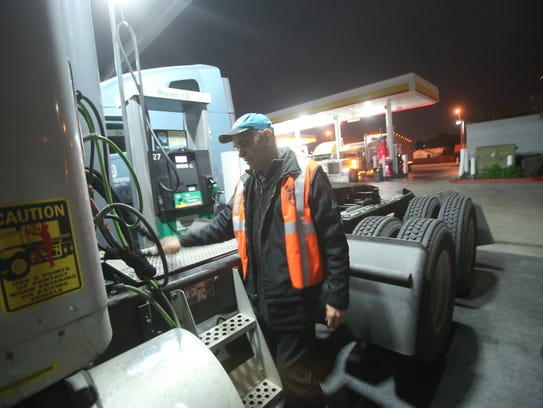 Carlos Garcia stops by at a gas station to fuel up