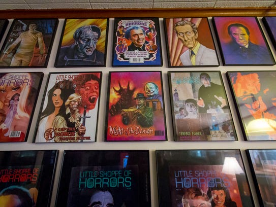 For 45 years Richard Klemensen has produced Little Shoppe of Horrors magazine, The Journal of Classic British Horror Films. Several of the magazine covers hang Tuesday, Oct. 24, 2017, at his home in Des Moines, Iowa.