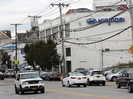 Traffic moves along the Hyundai and Mazda dealerships
