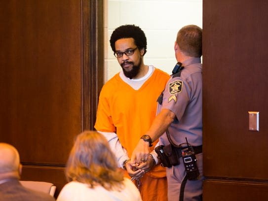 Mesac Damas, who pleaded guilty to murdering his wife, Guerline Dieu Damas, and their five children in September 2009 in their North Naples home, enters a Collier County courtroom in East Naples for his sentencing Friday, Oct. 27, 2017.