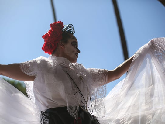 Students from the Son De Mexico dance school perform
