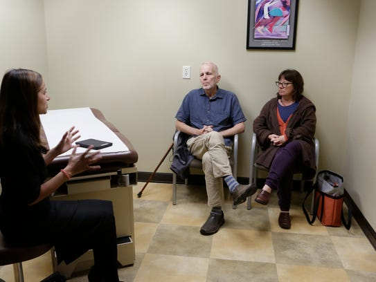 Dr. Fiona Gupta, a neurologist at the North Jersey Brain and Spine Center in Oradell, New Jersey, talks with Ed and Jill Bieber in a followup to Ed's Deep Brain Stimulation surgery, designed to lessen his Parkinson's symptoms.