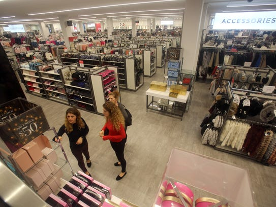 Shoppers browse at Century 21, located at the Mall