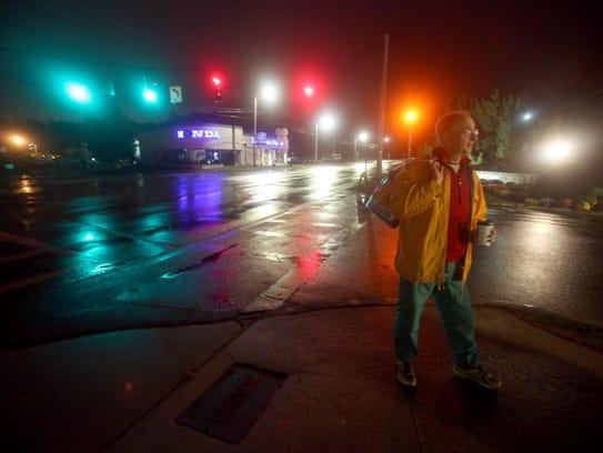 Michael Rubinfeld of Dobbs Ferry, N.Y., 70, waits before