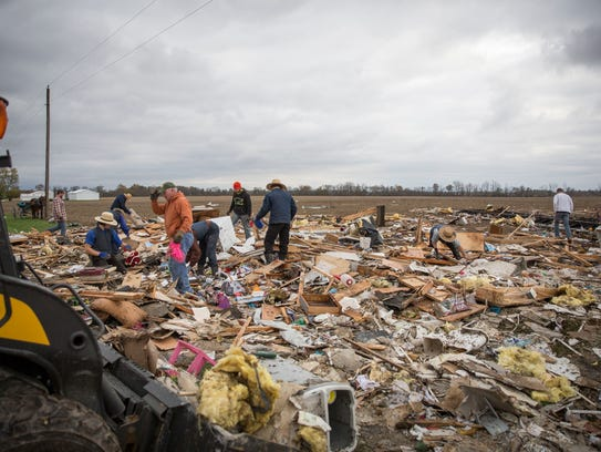 Family, friends and neighbors help clean up what remains