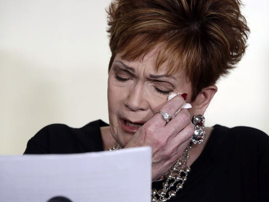 Beverly Young Nelson, an accuser of Alabama Republican Roy Moore, reads her statement at a news conference, in New York, Monday, Nov. 13, 2017. Nelson says Moore assaulted her when she was 16 and he offered her a ride home from a restaurant where she worked.