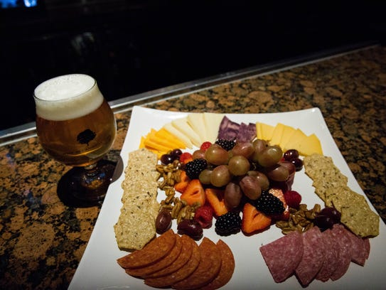 The Hop N'Wheat Session IPA and a cheese,fruit and chocolate nosh plate at the Pecan Grill and Brewery.