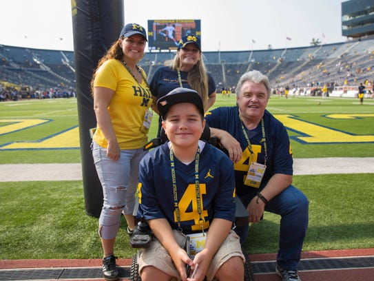 Gave Treve at the Big House with his grandpa, Bill Belcher, mom Christy Treve (right) and aunt Carrie Belcher.