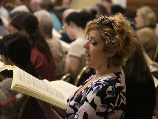 Melissa Kuder rehearses with the Tallahassee Community
