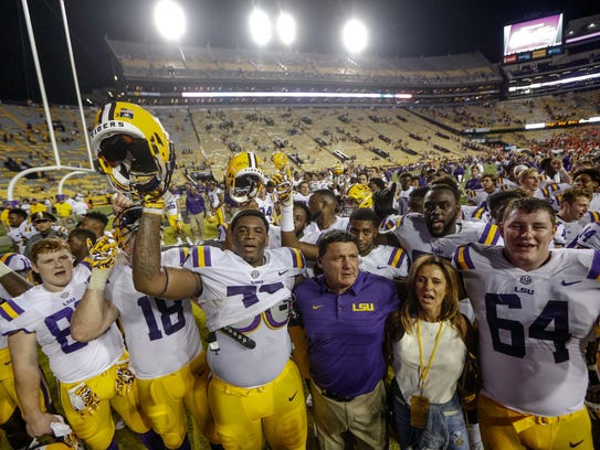 LSU coach Ed Orgeron celebrates with his team following