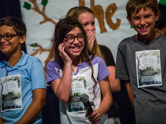 """Fifth-grade students present their book, """"The Day the Trees Laid Down,"""" in the cafeteria of Pelican Marsh Elementary School in North Naples on Friday, Nov. 17, 2017. The book is a collection of stories from students about their experiences related to Hurricane Irma."""