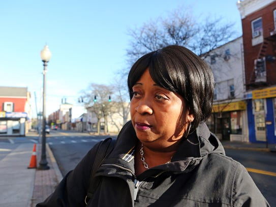Mary Jean Louis, 53, of Spring Valley responds to the