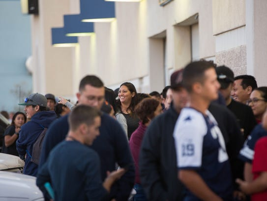 Customers wait in line outside the Best Buy building Thursday Nov. 23, 2017, for the store to open its doors at 5 pm. Some of the customers had waited in line since Wednesday night.
