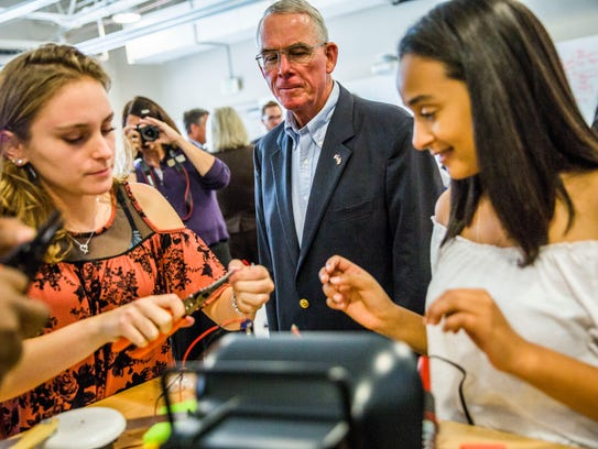 U.S. Rep. Francis Rooney visits students in a robotics class at FSW Collegiate High School in Fort Myers on Monday, Nov. 27, 2017.