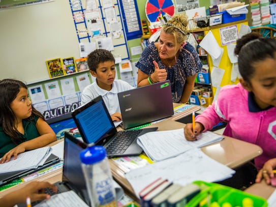 Ann Marie Morgiewicz works with her students at the Redlands Christian Migrant Association in Immokalee on Tuesday, Nov. 14, 2017. Morgiewicz set up a pen pal relationship with a Sandy Hook Elementary class after the shooting at the school in Newtown, Connecticut.