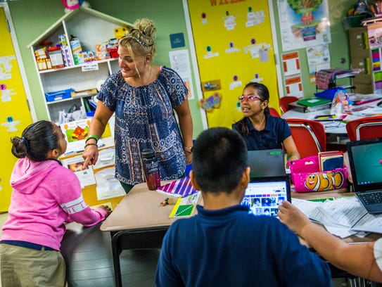 Ann Marie Morgiewicz works with her students at the Redlands Christian Migrant Association in Immokalee on Tuesday, Nov. 14, 2017. Morgiewicz set up a pen pal relationship with a Sandy Hook Elementary class after the shooting at the school in Newtown, Conn.