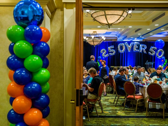 """Attendees greet each other during the third annual """"25 Over 50"""" awards presentation sponsored by the Naples Daily News at the Hilton Naples on Wednesday, Nov. 29, 2017."""