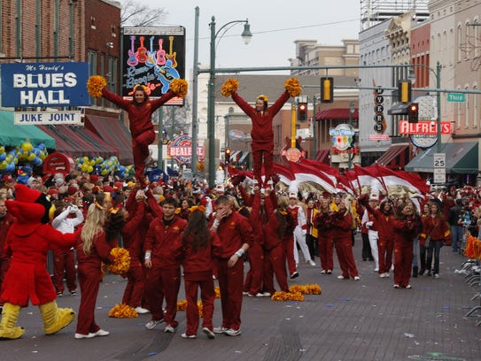 Iowa State Cyclones cheerleaders cheer on their team