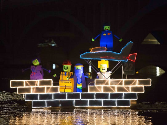 Boats with all different types of lighting designs go town Tempe Town Lake during the Fantasy of Lights Boat Parade at Tempe Beach Park, Saturday, December 14th, 2014 in Tempe, Ariz.
