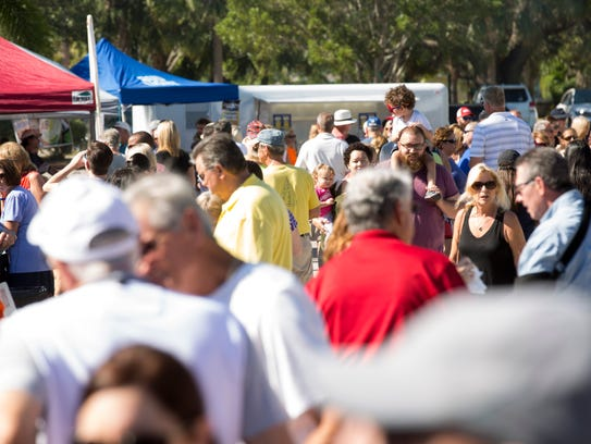 Locals and vacationers alike make their way through