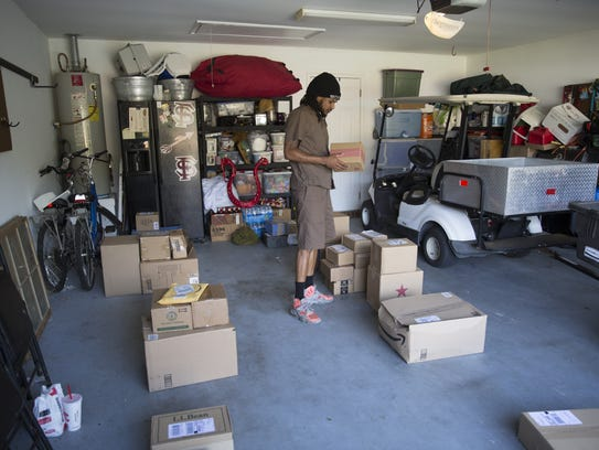 UPS Driver A.C. Miller sorts packages for delivery