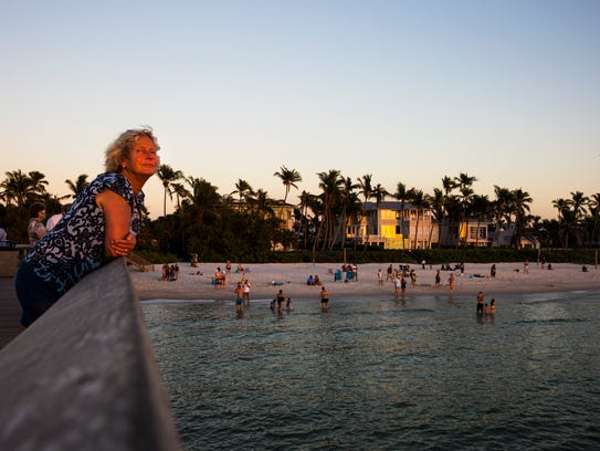 People watch the sunset at Naples Pier on Wednesday,