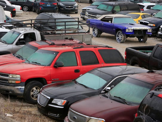 A view of some of the 2,100 cars currently at the Louisville Metro Police impound lot. City officials hope to move the lot away from the Beargrass Creek area. Dec. 11, 2017.